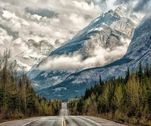 mountains, road, and clouds image