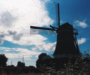 city, clouds, and windmill image