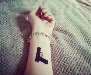 gun and tattoo image