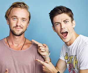 tom felton, the flash, and grant gustin image