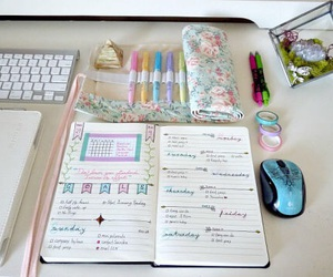 journal, notebook, and pens image