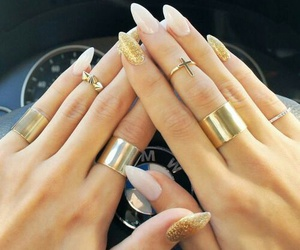 gold rings, cross rings, and gold glitter nails image