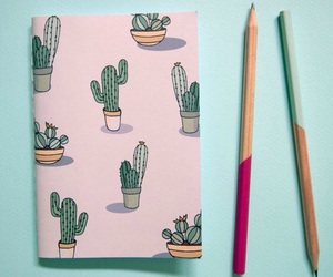 cactus, notebook, and pencils image