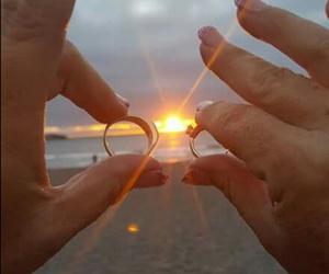 beach, sunset, and wedding rings image