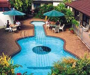 guitar, pool, and swimming pool image