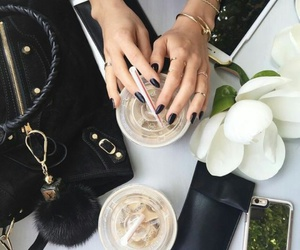 iced coffee, black almond nails, and white flowers image