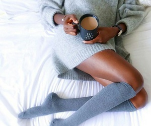 coffee, grey knit turtleneck, and gold bracelets image