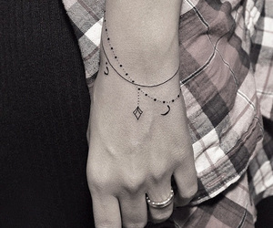 tattoo and bracelet image