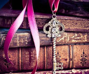 book, key, and pink image
