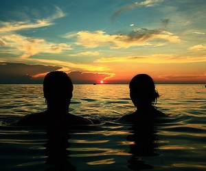 couple, sea, and sunset image