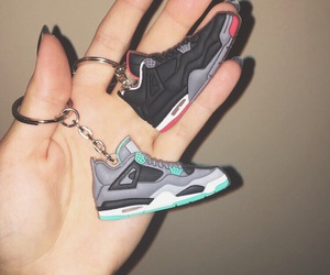 iv, keychain, and sneakers image