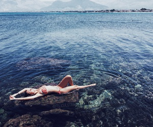blue sky, blue water, and paradise image
