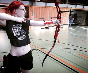 archery, arrow, and belly button piercing image