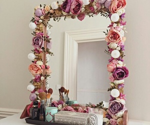 flowers, mirror, and makeup image
