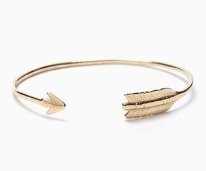 arrow, gold, and bracelet image