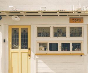 building, yellow, and cafe image