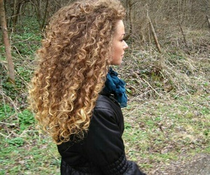 black coat, blue scarf, and curly ombre hair image