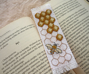 bee, book worm, and cross stitch image
