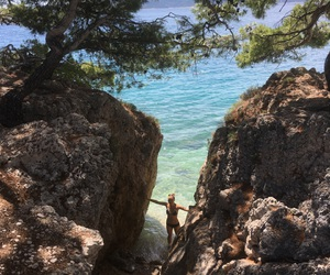 cliff, girl, and ocean image