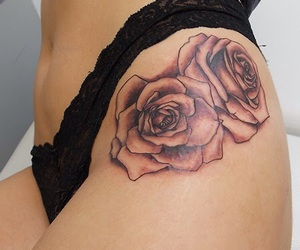 flower tattoo, rose tattoo, and thigh tattoo image