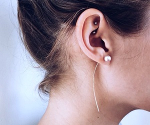 piercing and rook image