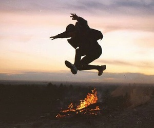 fire, jump, and boy image