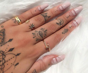 finger tattoo, hand tattoos, and gold rings image