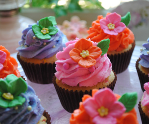 confetti, cupcakes, and tropical flowers image