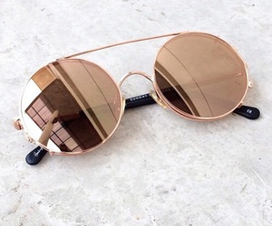 gold and sunglasses image