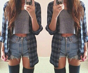 black knee high socks, denim high waisted shorts, and long wavy brown hair image