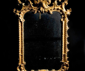 gold, black, and mirror image