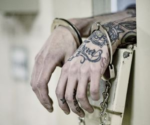 tattoo, hands, and handcuffs image