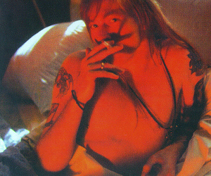 axl rose, cigarrette, and Guns N Roses image