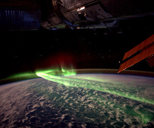space, earth, and aurora image
