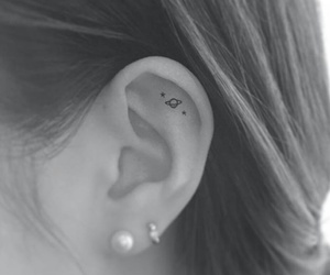 tattoo, ear, and planet image