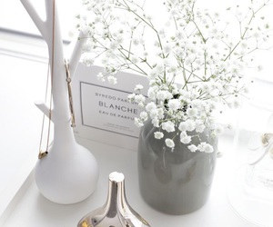 white, flowers, and watch image