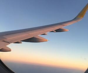 holidays, plane, and sky image