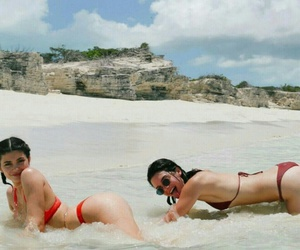 kylie jenner, kendall jenner, and beach image