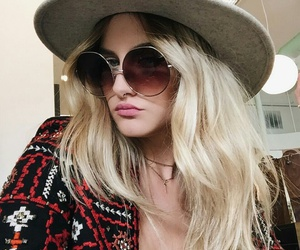 septum piercing, gold necklaces, and circle sunglasses image