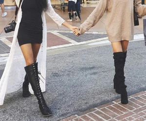 black dress, beige sweater, and black thigh high boots image