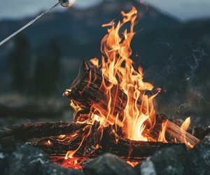 camp and fire image
