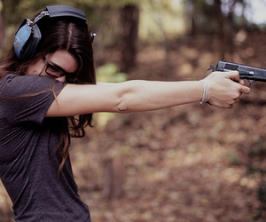 girl, gun, and glasses image