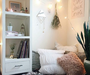 green plants, jewelry display, and boho decor image