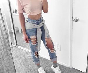 grey socks, white sneakers, and blue ripped jeans image