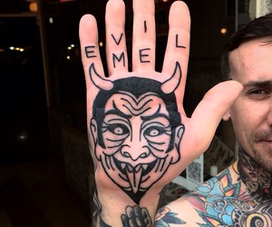 Devil, hand, and hand tattoo image