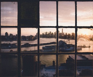 city, window, and sunset image