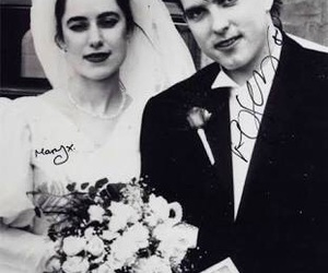 robert smith, the cure, and wedding image