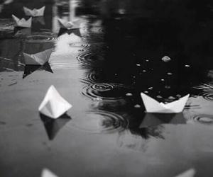 boat, rain, and water image