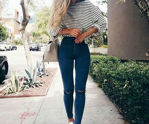 white sneakers, long wavy blonde hair, and blue knee ripped jeans image