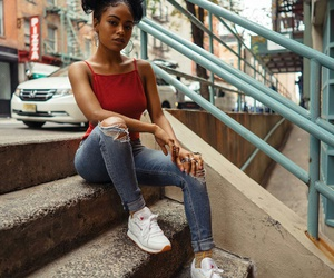 white sneakers, silver rings, and red tank top image